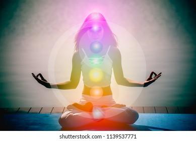 Yoga meditation woman pose with seven chakras, aura, spiritual and Yin Yang symbols.
