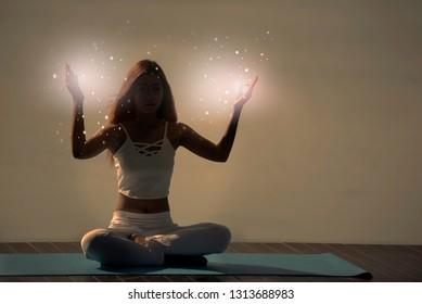 Yoga meditation woman pose with seven chakras, aura, spiritual.