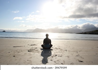 yoga on the beach silhouette, lofoten norway