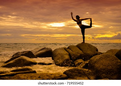 Yoga on the rock at the sunset with the murmur of waves.