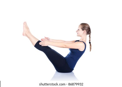 Yoga paripurna navasana boat pose by beautiful Caucasian woman in blue Capri and top at white background. Free space for text