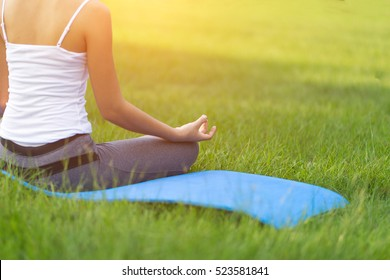 Yoga in the park, outdoor with effect light, health woman, Yoga woman. Concept of healthy lifestyle and relaxation.