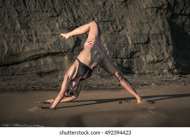 Yoga poses on a sandy beach