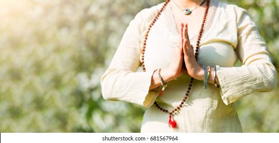 Yoga position in a girl's prayer.