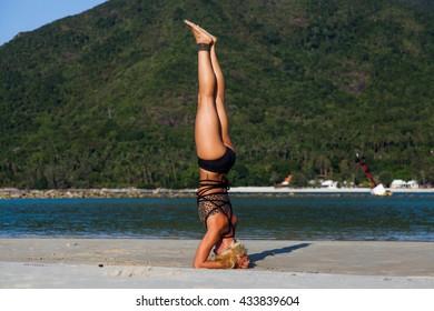 Yoga position on the beach