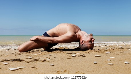 Yoga practice. Man doing vriation of fish yoga pose