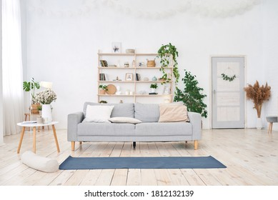 yoga room with big light window in modern white flat. Yoga mat on the floor, no people