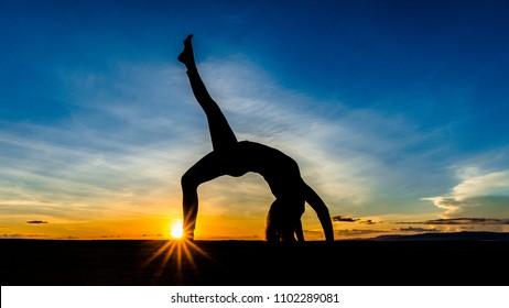 Yoga session on a beautiful sunset.