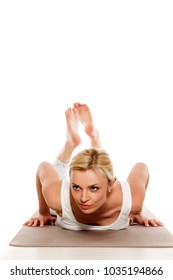 Yoga, sport, training and lifestyle concept - Young blonde woman doing yoga exercise. Portrait of young beautiful woman in white sportswear doing pushups.