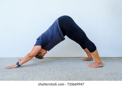 Yoga students showing different yoga poses.