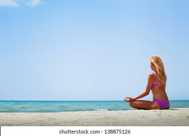 yoga in sunny day on the beach