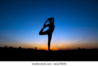 YOGA in sunset background