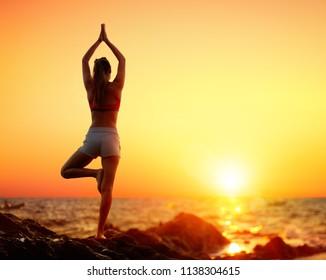 Yoga At Sunset - Girl In Vrikshasana Pose