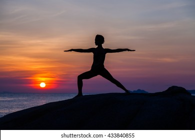 Yoga at sunset time