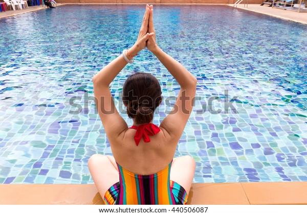Yoga at swimming pool.