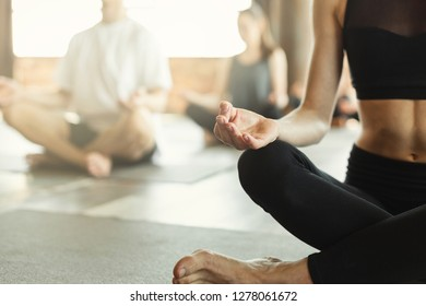 Yoga teacher with group, sitting in Sukhasana exercise, Easy Seat pose with yoga mudra. Keep calm and do yoga, concept, copy space