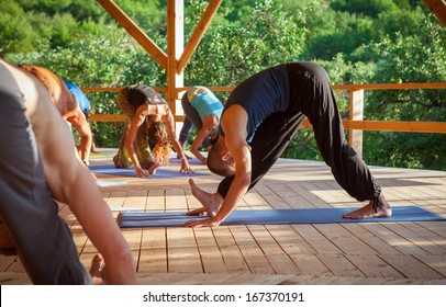 Yoga teacher shows exercise for group