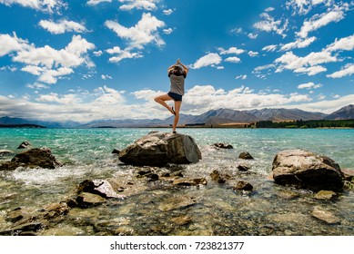 Yoga tree posture in front of Lake Tekapo, New Zealand