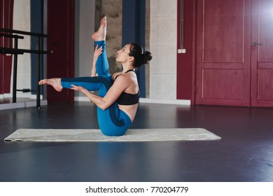 Yoga. Woman doing exercises in the gym