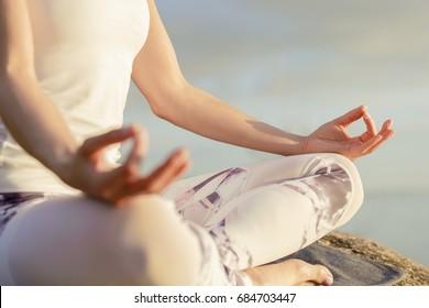 yoga woman meditating outdoors, close-up hands