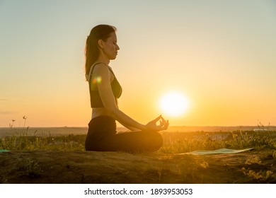 Yoga woman meditating at sunset. Concept of healthy lifestyle and relaxation
