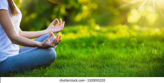 Yoga woman meditating at sunset. Female model meditating in serene harmony
