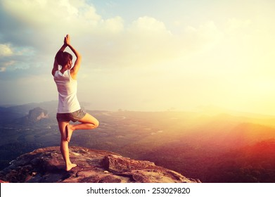 yoga woman mountain peak