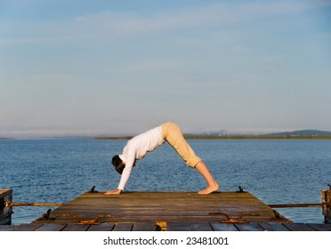 Yoga Woman on a dock by the ocean