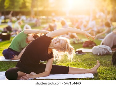 Yoga woman on green grass.