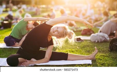 Yoga woman on green grass.