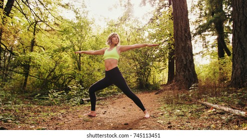 yoga Woman In woods Exercising Outdoors balance