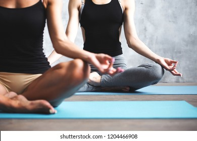 Yoga women. Meditating together.