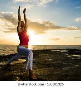 Yoga women practising her strength and balance