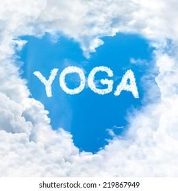yoga word nature on blue sky inside love heart cloud form