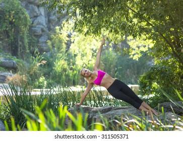 Yoga. Young woman doing yoga asana in beautiful nature outdoor