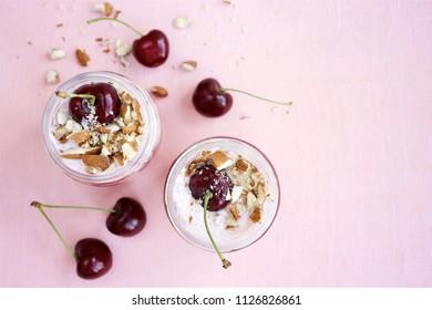 Yoghurt or cottage cheese dessert with dark cherry. Summer  breakfast in jar