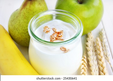 yoghurt in a glass and raw fruits