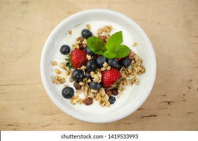 Yoghurt with granola with fresh fruits
