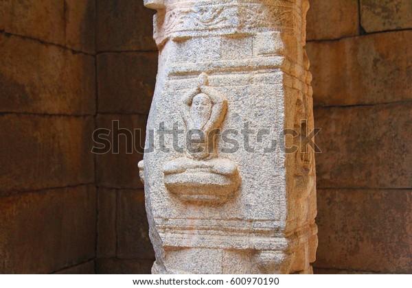 Yogi symbol on the column in the temple of India Hampi