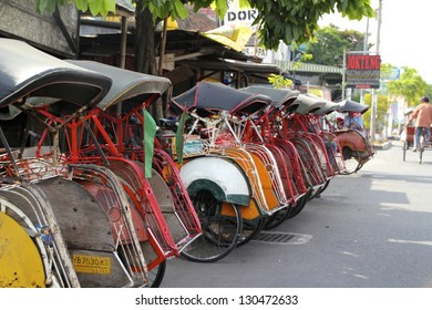 YOGJAKARTA, INDONESIA, JUNE 28 : Becaks are waiting for clients on June 28 2012. They are able to support the tourism on the local economy.