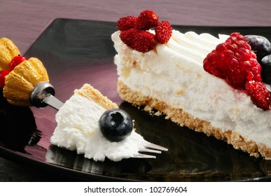 yogurt cake with red fruits over ardesia table