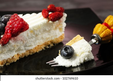 yogurt cake with red fruits over ardesia