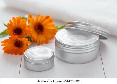 Yogurt cosmetic cream with calendula flowers vitamin spa lotion organic herbal skin cleansing moisturizer product. Medical dermatology anti aging, acne, blemish, pimple, blackhead clear treatment