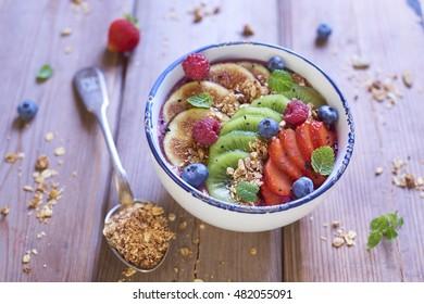 Yogurt dessert with homemade granola and berries