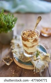 Yogurt dessert with homemade granola and persimmon