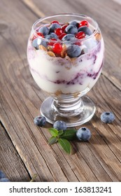 yogurt with fresh blueberries in a glass