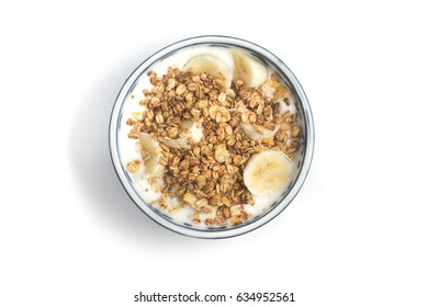 Yogurt, Granola and Banana into a bowl isolated on white background