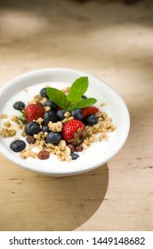Yogurt with granola and fruits, breakfast