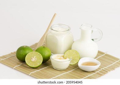 Yogurt, lemon, fresh milk, and honey, healthy food.