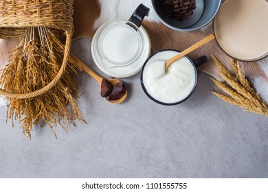 Yogurt and milk on a table with cowhide on groud. Flat lay image with copy space for your text